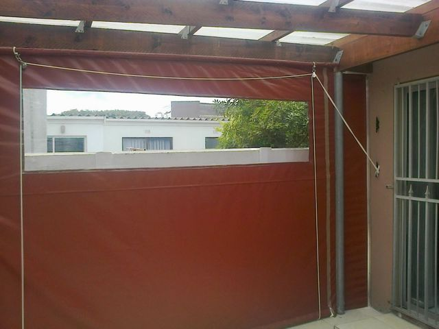 burgundy PVC outdoor blind with window