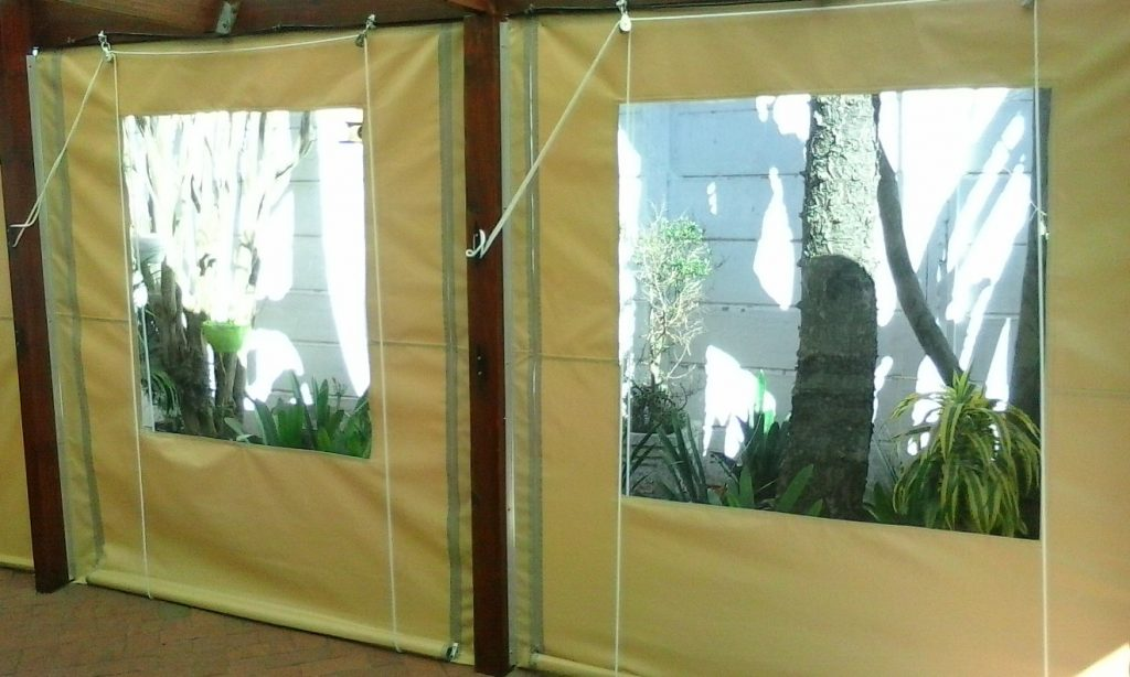Beige outdoor blind with clear plastic window
