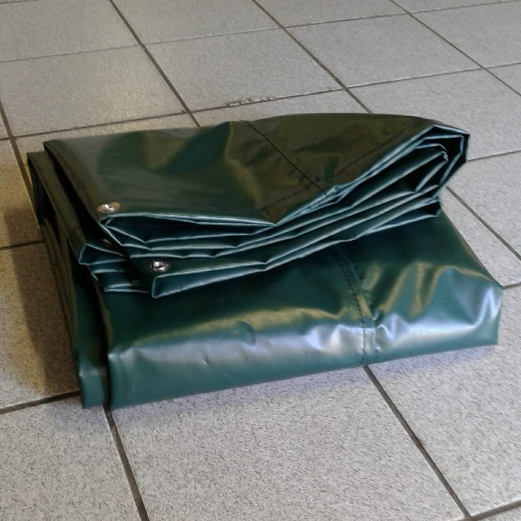 Green PVC tarpaulin folded up